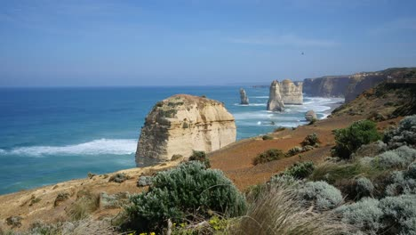 Australia-Great-Ocean-Road-12-Apostles-Vista-Of-Sea-Stacks-Beyond-Shrubs