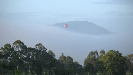 Australia-Outlook-Hill-With-Balloon-Descending-Toward-Mist