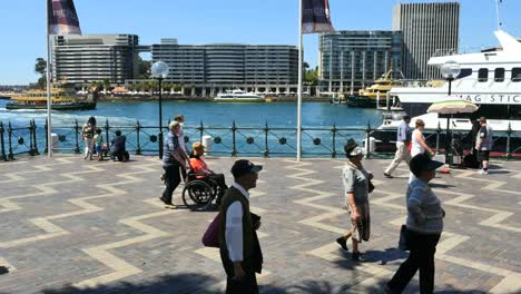 Australia-Sydney-People-Walking-By-Water-With-Excursion-Boat