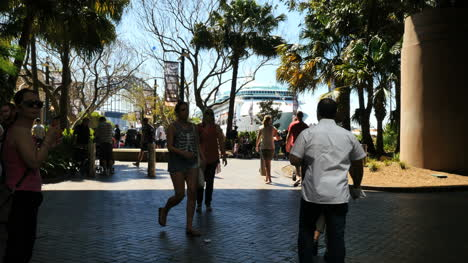 Australia-Sydney-People-Walk-In-Park-With-Ship-Beyond
