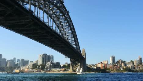 Australia-Sydney-Sailboat-Moves-Under-Harbour-Bridge