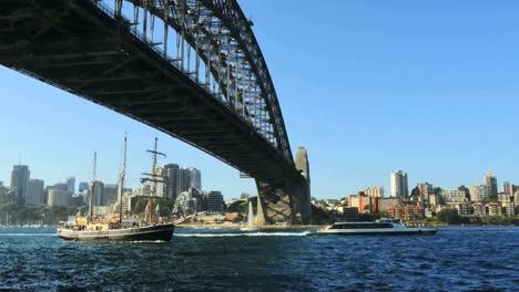 Australia-Sydney-Several-Boats-Move-Under-Harbour-Bridge
