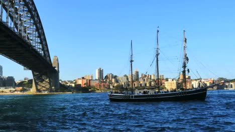 Australia-Sydney-Traditional-Ship-Sails-By-Harbour-Bridge