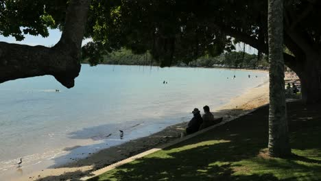 New-Caledonia-Noumea-Lagoon-With-People-Sitting-On-Bench