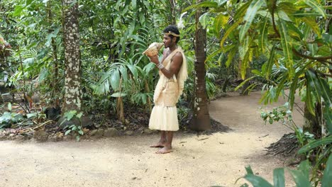 Vanuatu-Man-Blowing-Conch-Shell-By-Forest