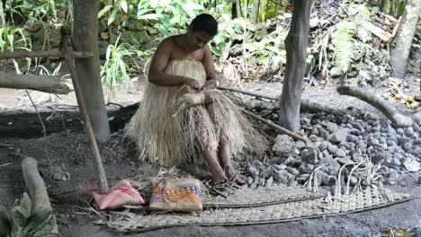 Vanuatu-Woman-Weaving-Grass
