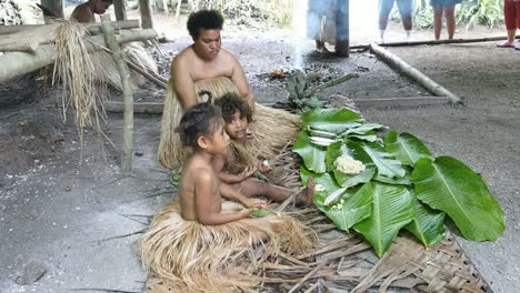 Vanuatu-Woman-With-Girls-Preparing-Food