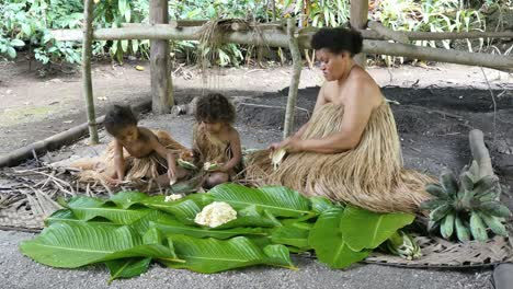 Vanuatu-Woman-With-Two-Children-Preparing-Food