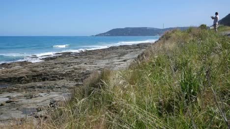Australia-Great-Ocean-Road-Rocky-Outcrop-And-Photographer