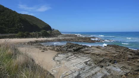 Australia-Great-Ocean-Road-Rocky-Outcrop-Beyond-Grass-Pan