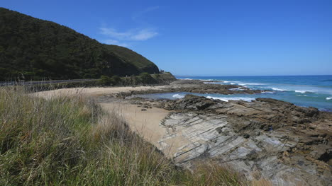 Australia-Great-Ocean-Road-Rocky-Outcrop-Beyond-Grass