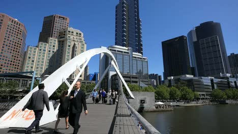 Australia-Melbourne-Foot-Bridge-Yarra-River-Includes-People-With-Suitcases