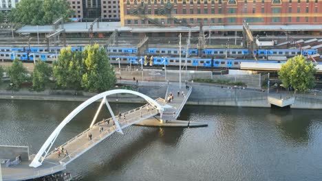 Australia-Melbourne-Foot-Bridge-And-Passing-Train