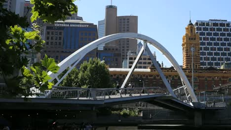 Australia-Melbourne-Foot-Bridge-With-Clock-Tower-Beyond-Pan