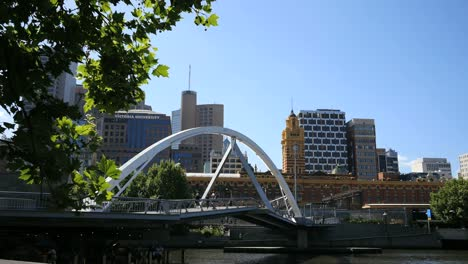 Australia-Melbourne-Foot-Bridge-With-Clock-Tower-Beyond