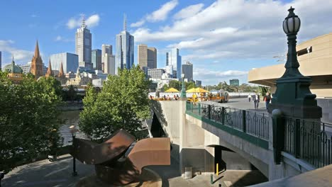 Australia-Melbourne-Sculpture-And-Skyline-Beyond-Cafe