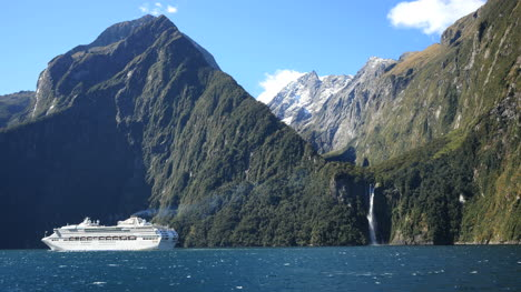 New-Zealand-Milford-Sound-Cruise-Ship-And-Waterfall