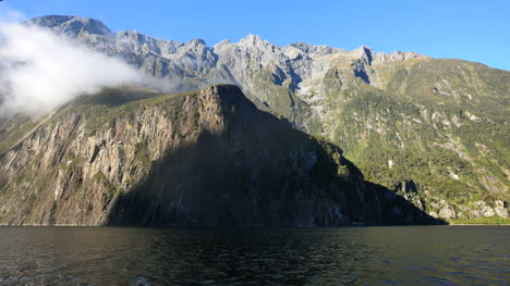 New-Zealand-Milford-Sound-Passing-Steep-Cliffs