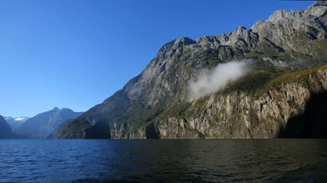 New-Zealand-Milford-Sound-Small-Cloud-On-Cliff