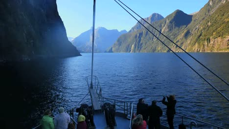 New-Zealand-Milford-Sound-With-People-On-Boat