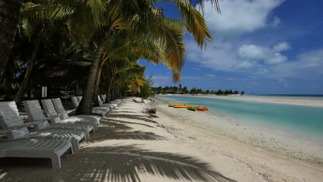 Aitutaki-Chairs-By-Lagoon-With-Palms-And-Shadows