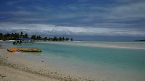 Aitutaki-Lagoon-With-Boats-On-Sand