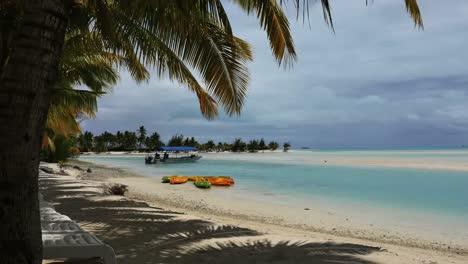 Aitutaki-Lagoon-With-Chairs-And-Boats