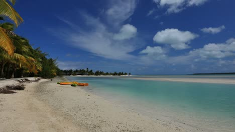 Aitutaki-Lagoon-With-Light-And-Shadow-And-Kayaks