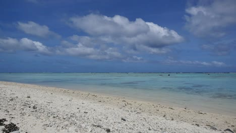 Aitutaki-White-Sand-Beach-And-Lagoon-With-Clouds-And-Bird-Flying