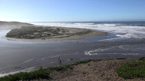 California-Salmon-Creek-Tidal-Bore-With-Couple