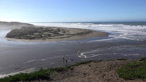 California-Salmon-Creek-Tidal-Bore-With-Woman-Wading