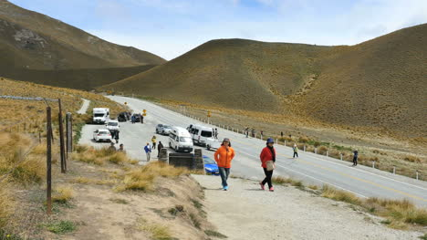 New-Zealand-Pass-With-Tourists-In-Red-Coats