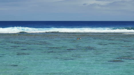 Rarotonga-Swimmer-And-Waves-On-Reef