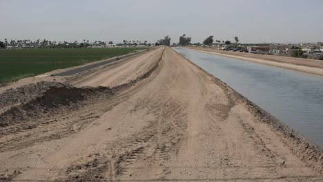Arizona-Dirt-Road-By-Irrigation-Canal
