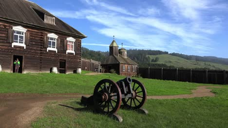 California-Fort-Ross-Cannon-With-Kuskov-House-And-Church