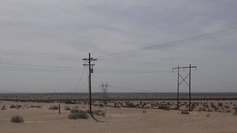 California-Sand-And-Power-Lines-With-Fence-Pan
