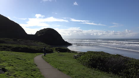 Oregon-Coastal-View-Of-Rocky-Headland-With-Man-Sound