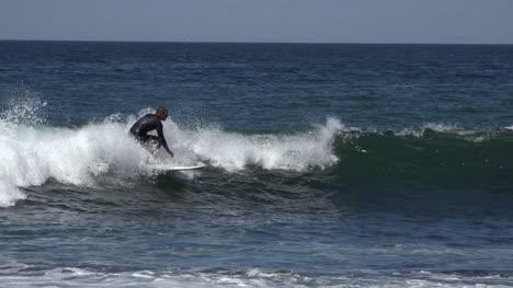 California-Santa-Cruz-A-Surfer-Rides-The-Waves