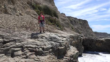 California-Santa-Cruz-Boy-On-Rocks-Along-Shore