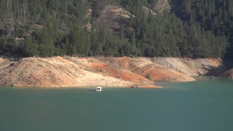 California-Shasta-Lake-With-Low-Water-Level-And-Boat