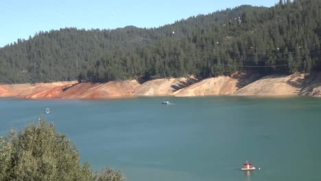 California-Shasta-Lake-With-Low-Water-Level-And-Small-Boat-Pan-And-Zoom