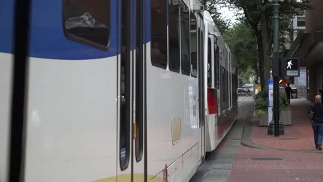 Oregon-Portland-Broadway-And-Yamhill-Streetcar-Goes-By