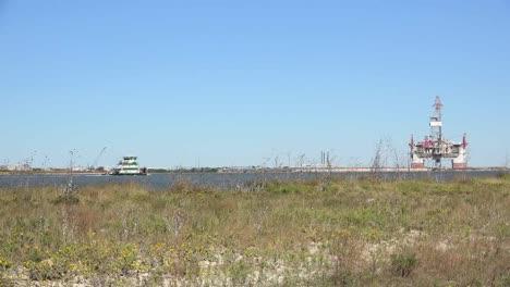 Texas-Port-Aransas-Work-Boat-Approaches-Oil-Drilling-Platform