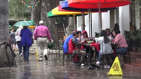 Texas-San-Antonio-People-Walking-Past-Umbrellas