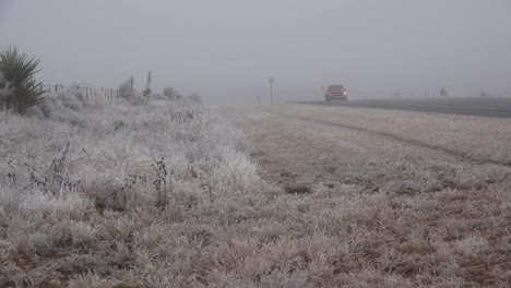 Texas-Icy-Roadside-With-Truck-Going-By