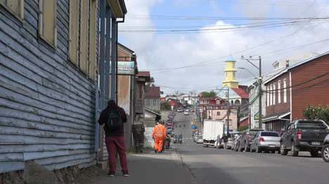 Chile-Chiloe-Chonchi-Zooms-To-Man-By-Street