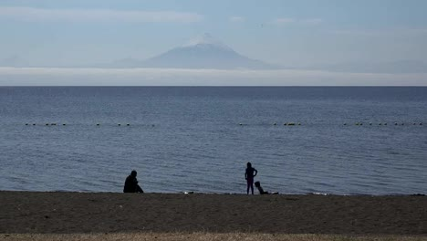 Chile-Lake-Llanquihue-And-Volcano-With-Children-Playing
