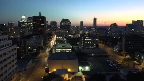 Texas-Austin-Traffic-On-Downtown-Street-At-Sunset-Zoom-In
