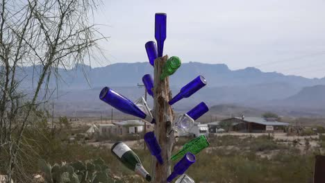 Texas-Terlingua-Bottles-Stuck-On-A-Pole