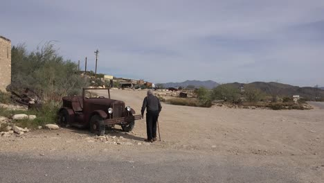Texas-Terlingua-Old-Man-Approaches-Old-Car